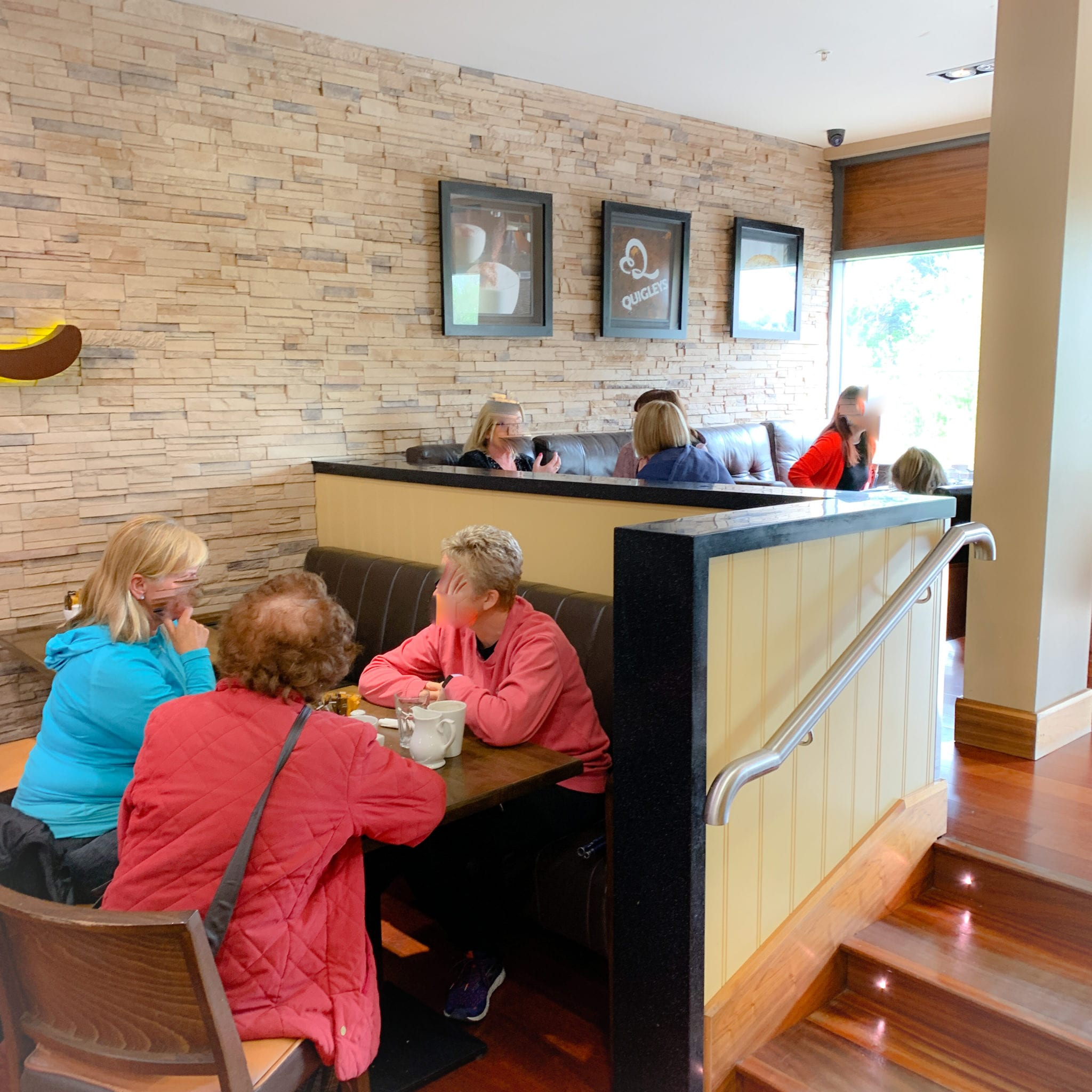 Customers talking while enjoying coffee in Quigleys cafe Thurles