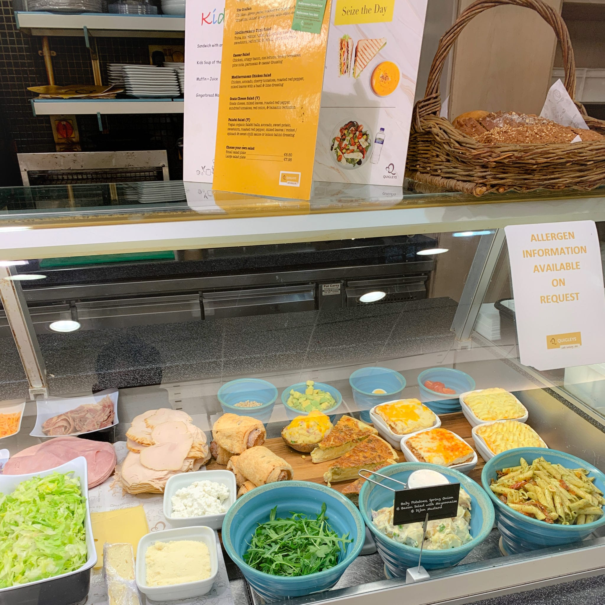 Cold meats, salad, pastas and quiche displayed in Quigley's deli