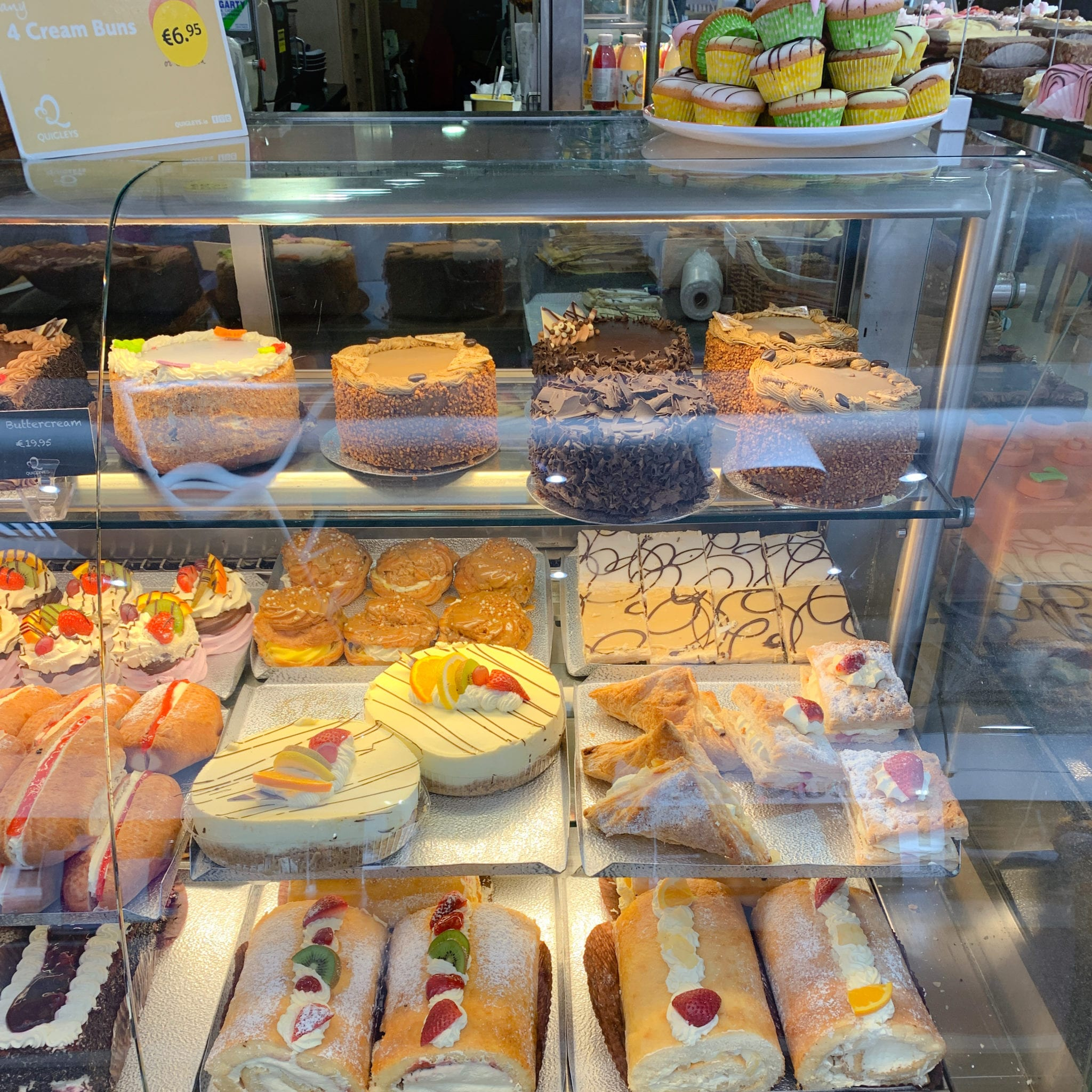 A selection of fresh cream cakes and buns available in Quigleys bakery